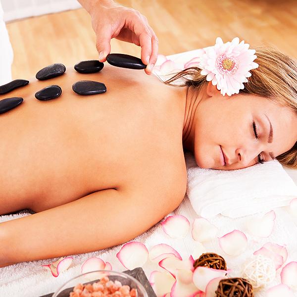 Hot stone massage or warm bamboo massage